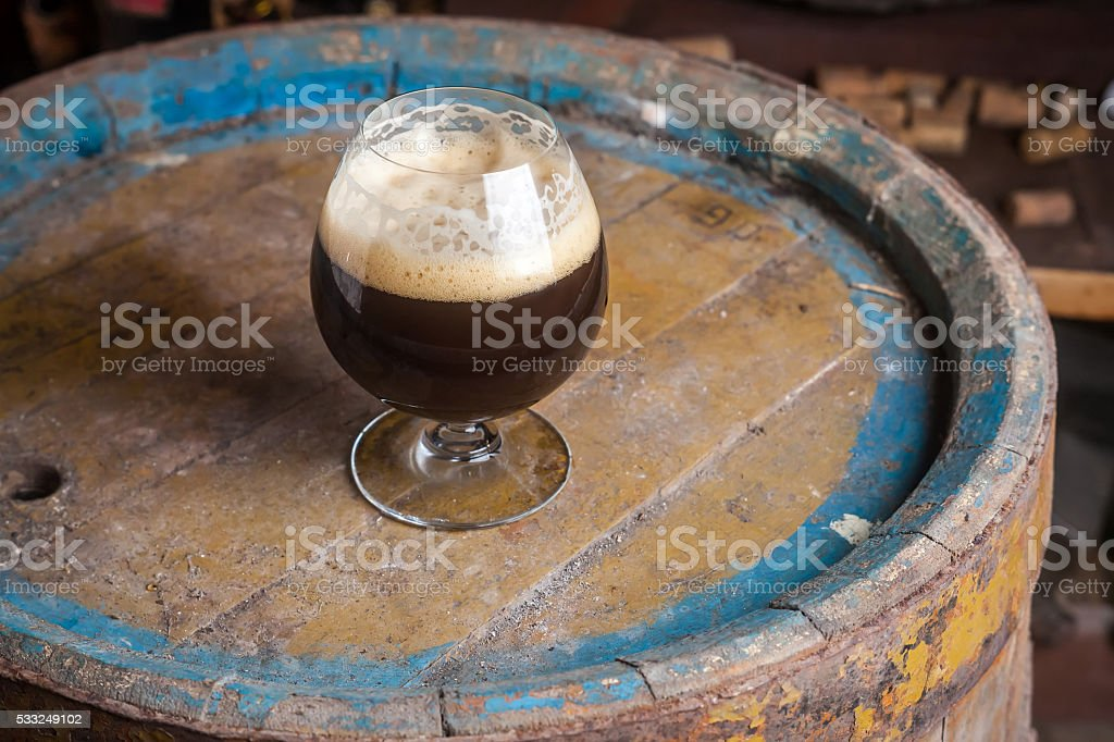 Dark beer in a cellar stock photo