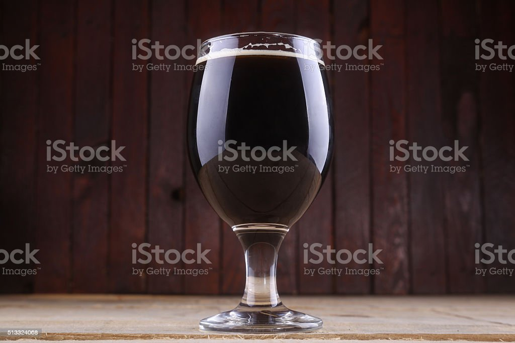 Dark beer in a glass stock photo