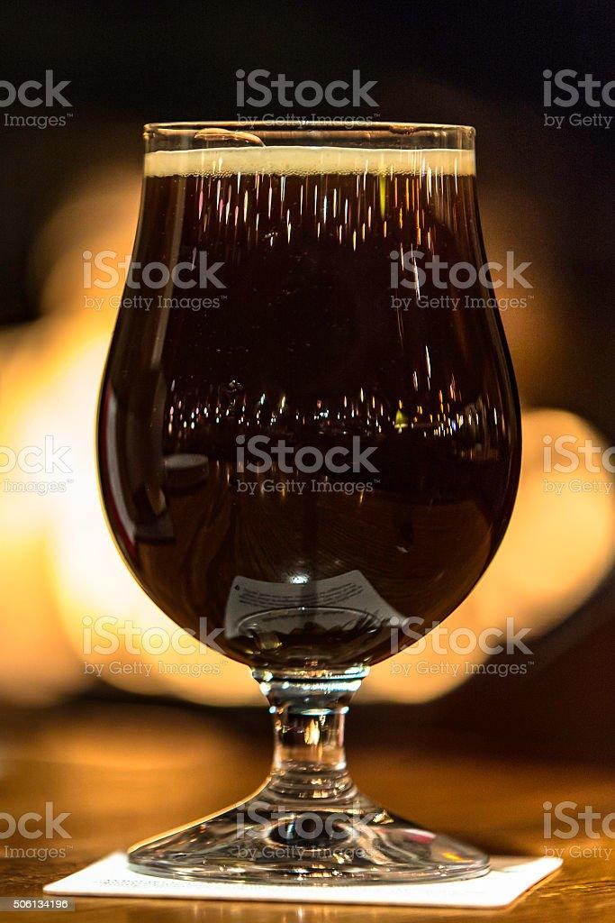 Dark beer in a snifter stock photo