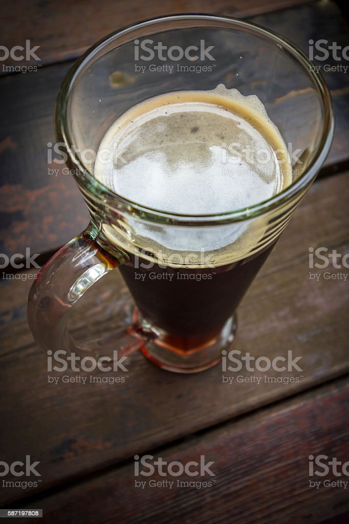 dark beer wood table stock photo