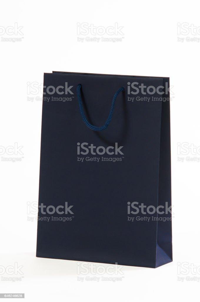 Dark blue, black paper bag on a white background stock photo