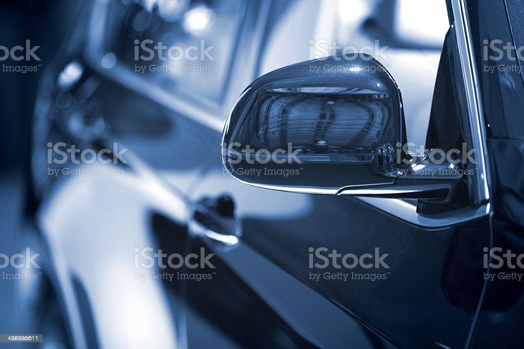 Dark blue Car side mirror at dealership - background royalty-free stock photo