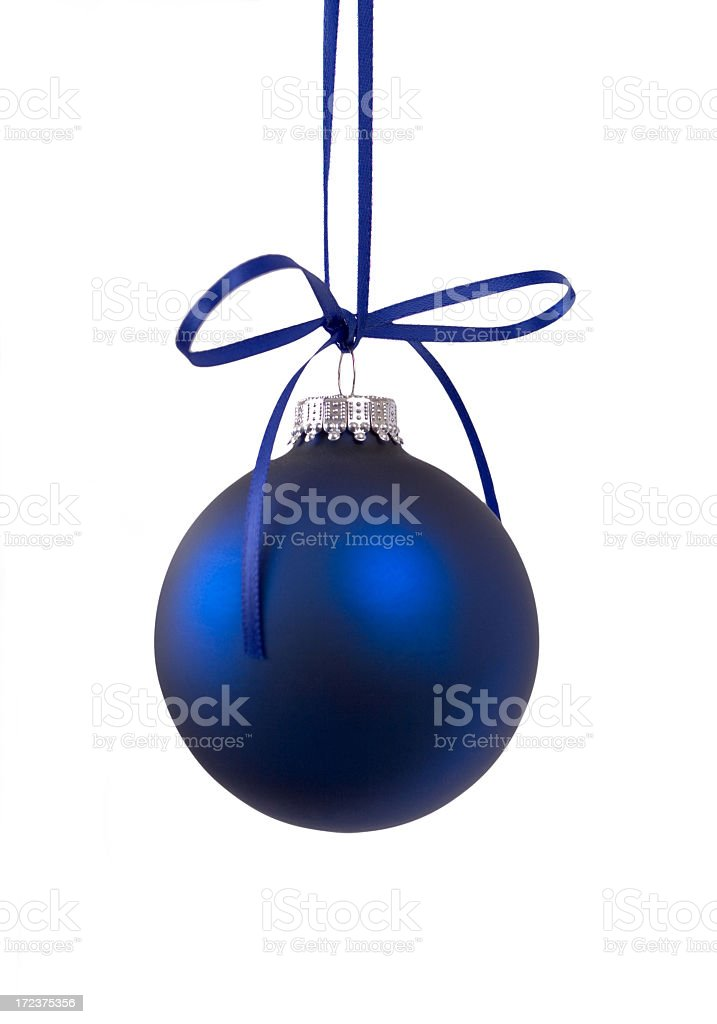 A dark blue Christmas bauble on a white background stock photo