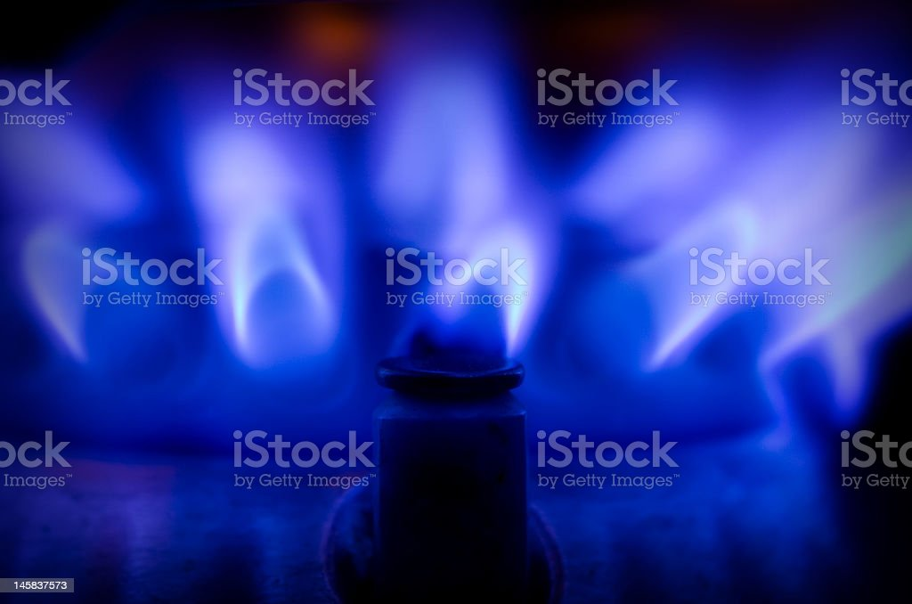 Dark blue gas flame with one flame at the front royalty-free stock photo
