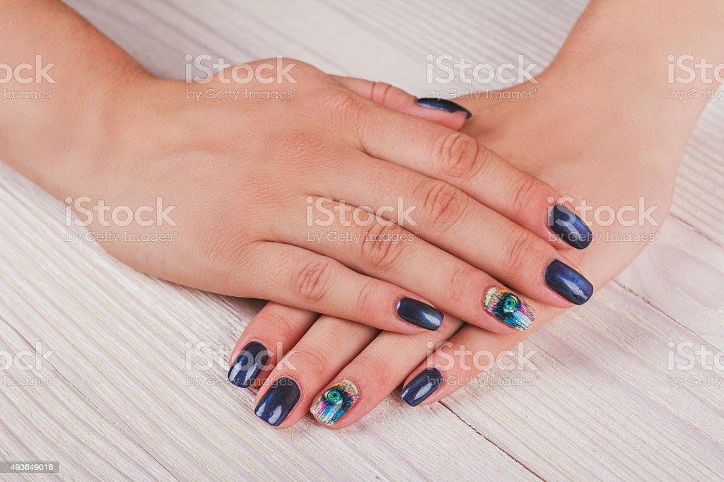 Dark blue nail art with print eye stock photo