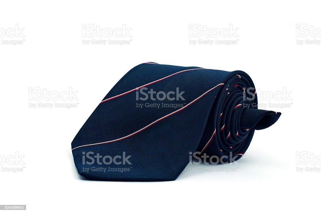 Dark blue necktie on white background stock photo