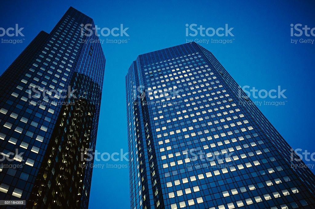 Dark blue office building at night - Deutsche Bank stock photo