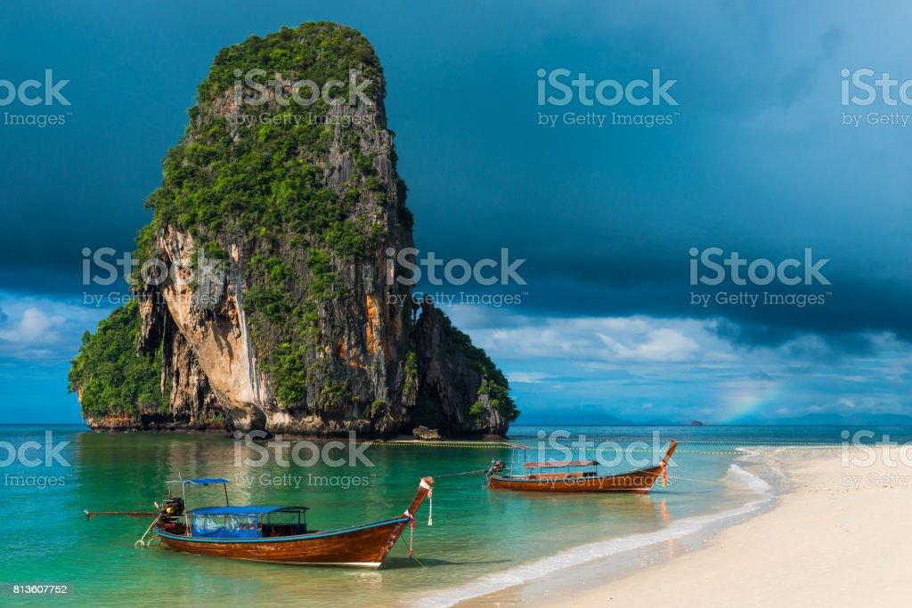 Dark blue photograph of rain clouds and beautiful mountains, Thailand, Phra Nang beach stock photo