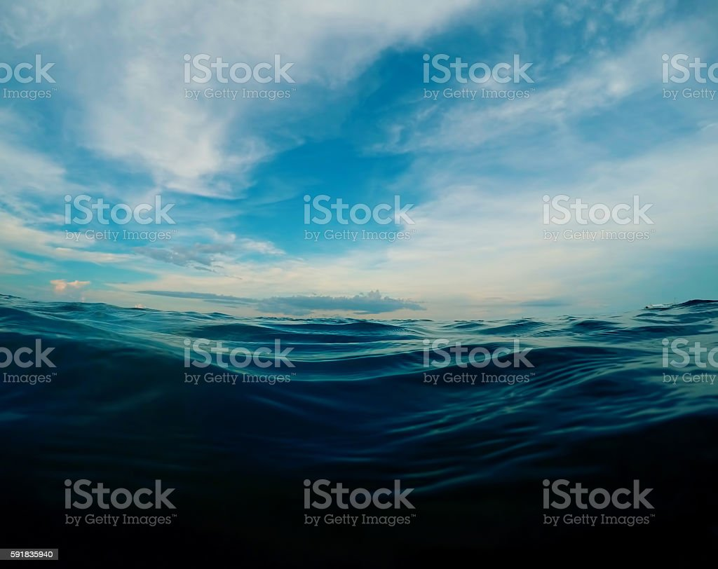 Dark blue sea water look through stock photo