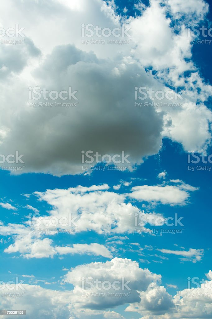 Dark blue sky and white summer clouds stock photo