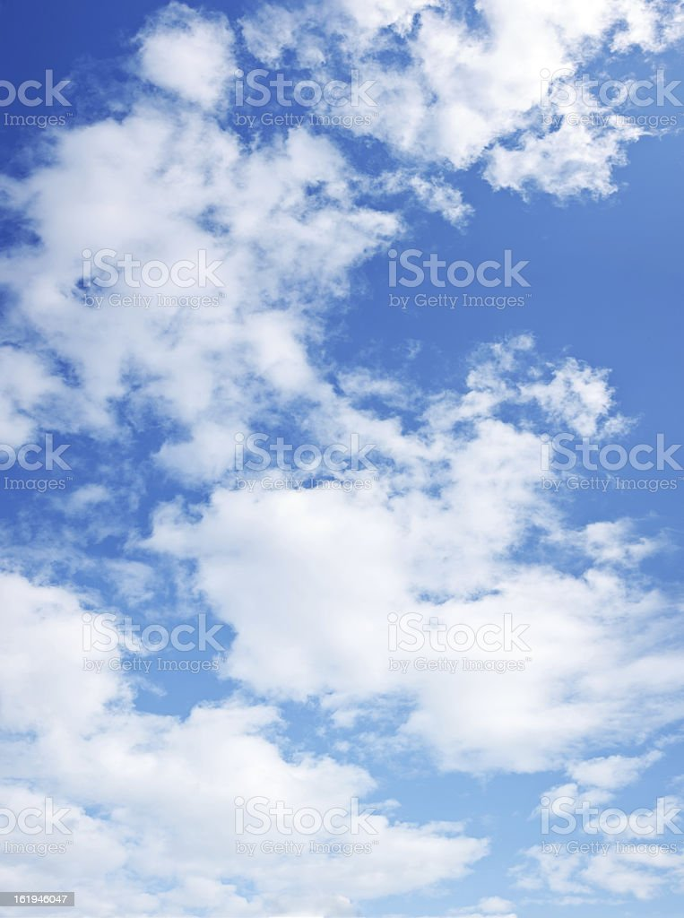 Dark blue sky with lots of white clouds royalty-free stock photo