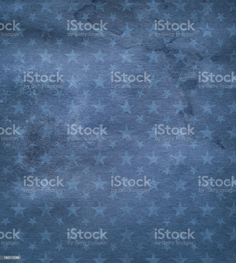 High resolution dark blue stained paper with stars stock photo