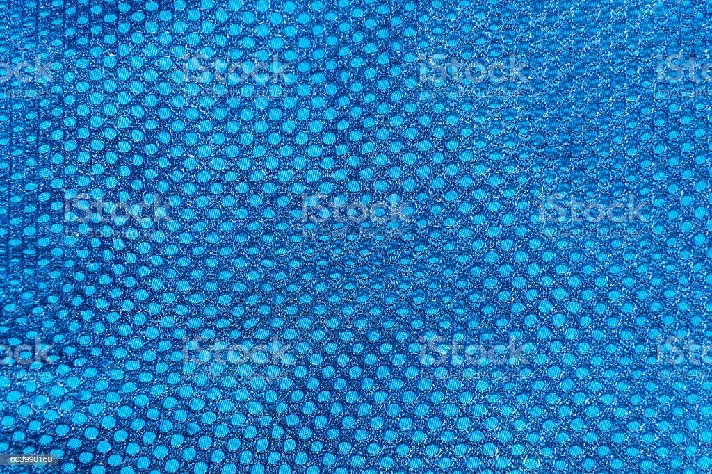 dark blue texture of the mesh sport fabric closeup stock photo