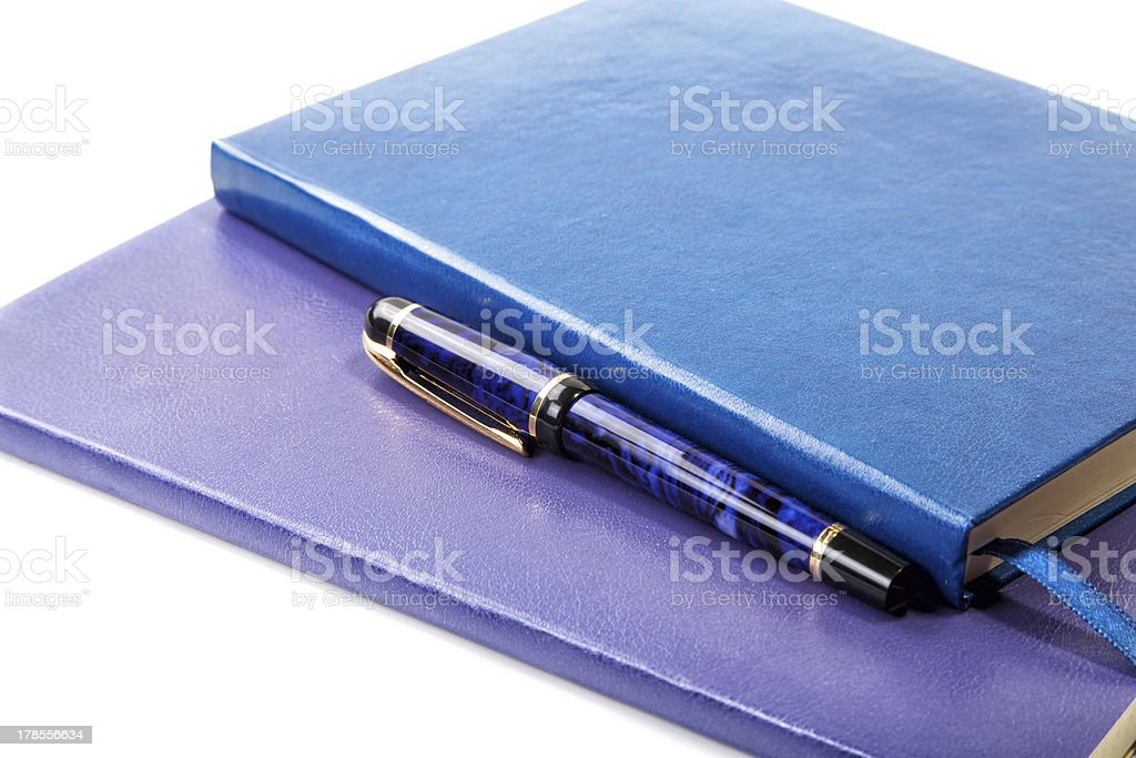 Dark blue writing-books and fountain pen isolated royalty-free stock photo