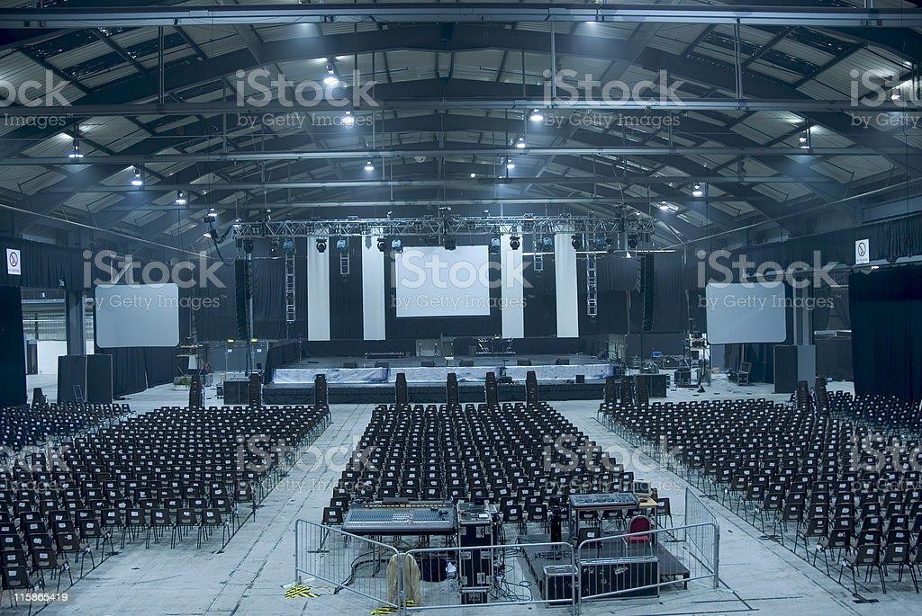 Dark blue-toned large empty auditorium hall royalty-free stock photo