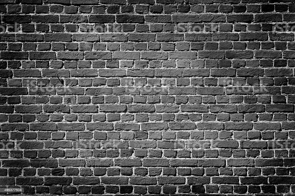 Dark brick wall stock photo