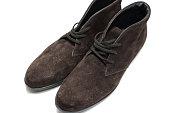 dark brown deerskin shoe with white background