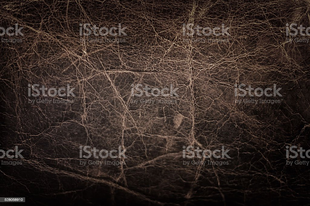 dark brown leather with deep scratches stock photo