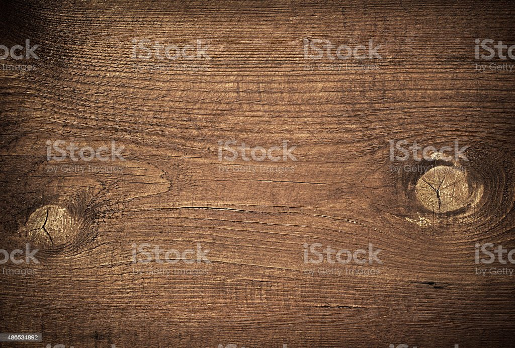 Dark brown scratched wooden cutting board with branch. Wood texture stock photo