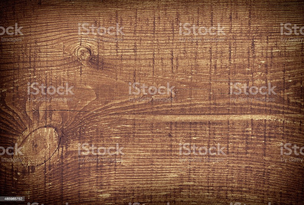 Dark brown scratched wooden cutting board. Wood texture stock photo