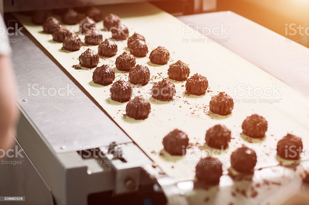 Dark brown sweets with shavings. stock photo