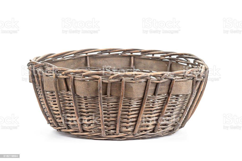 Dark brown wicker basket on white stock photo