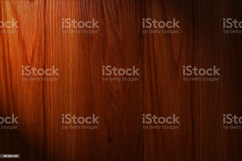 Dark brown wood background with light stock photo