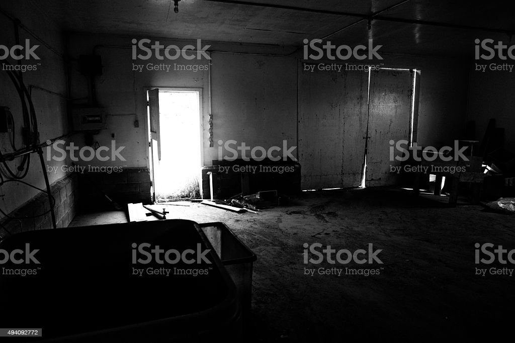 Dark Building With Light Pouring In stock photo
