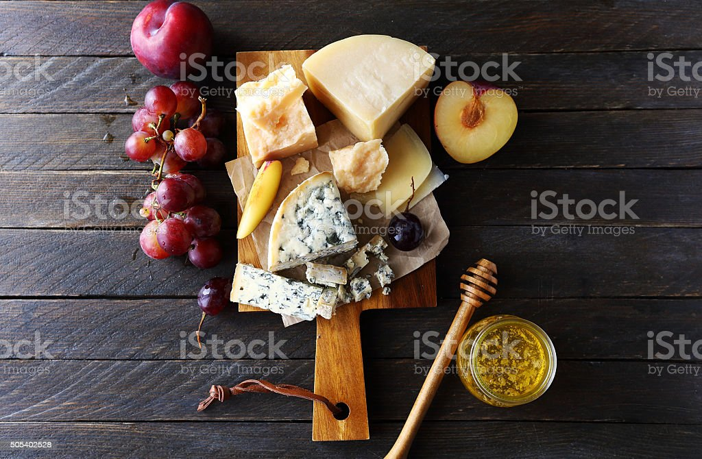 dark cheese composition stock photo