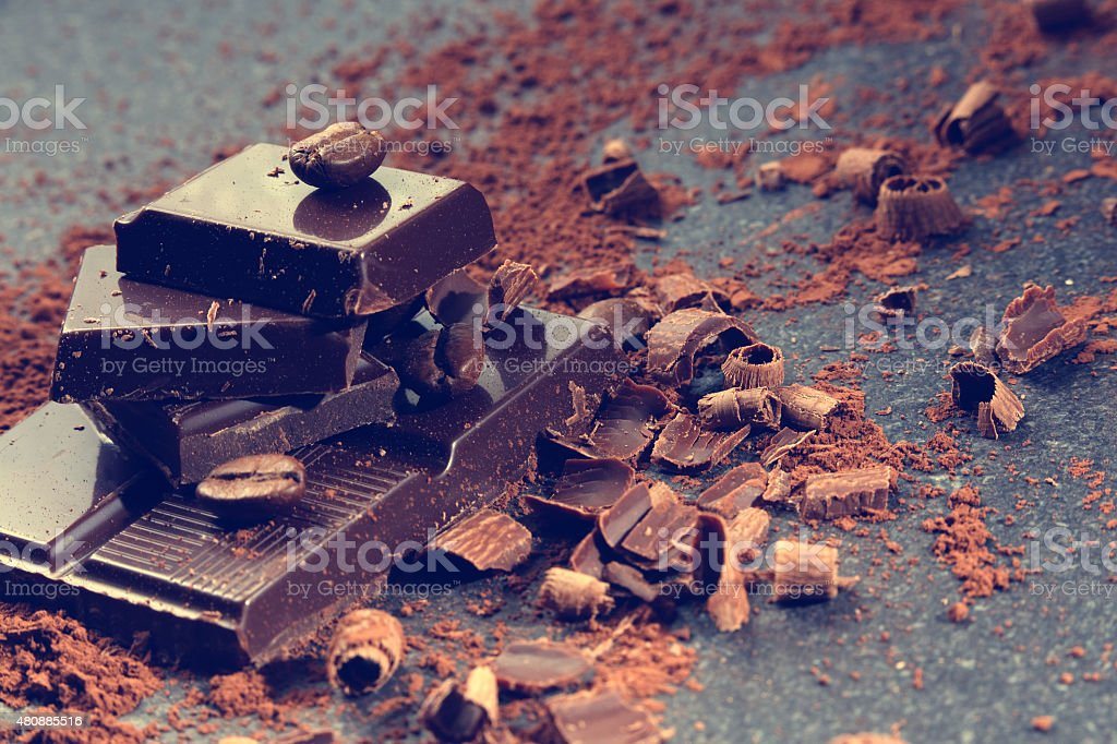 Dark chocolate and coffee bean on a stone table stock photo