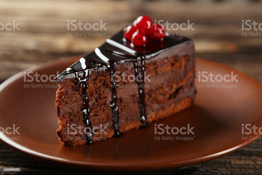 Dark chocolate cake on brown wooden background stock photo