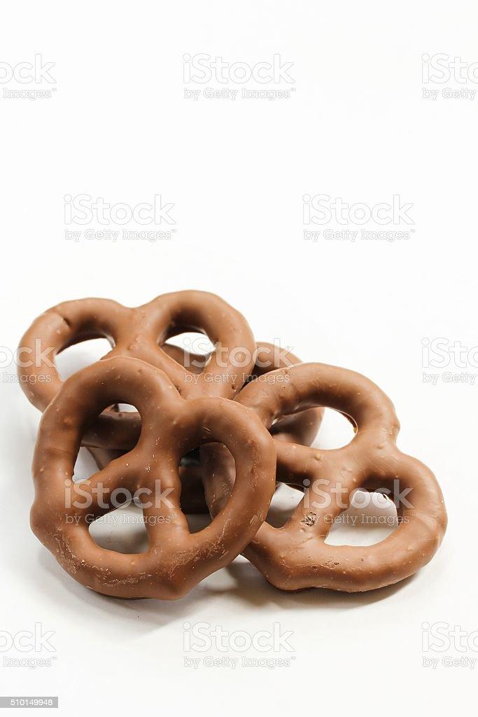 Dark chocolate covered pretzel stock photo