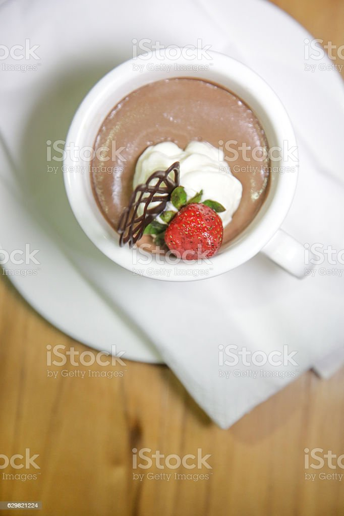 Dark chocolate mousse with whipped cream and strawberry stock photo