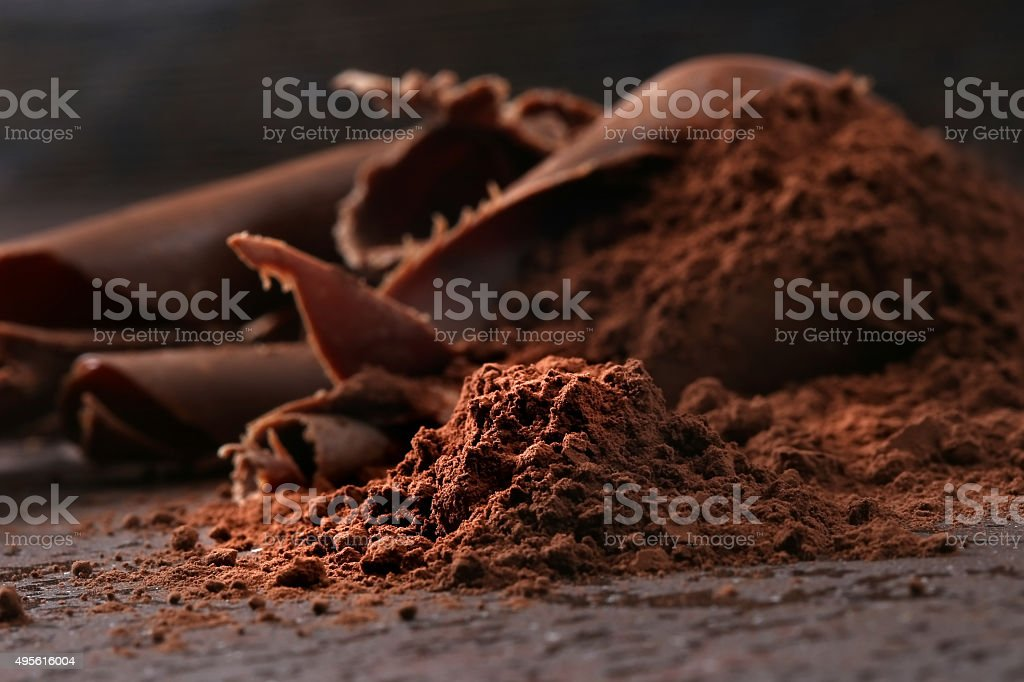 Dark chocolate shavings and sprinkled cocoa powder stock photo