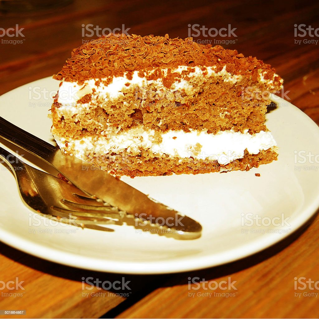 Dark Chocolate Sponge Cakes with shavings and curls. vintage filter. royalty-free stock photo