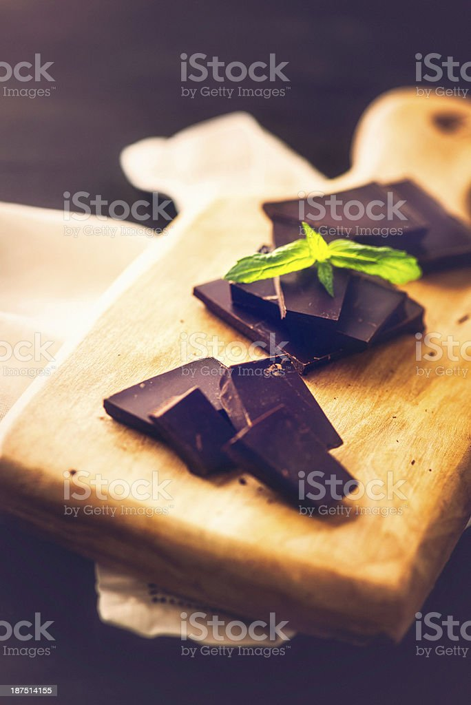 Dark Chocolate with Mint Leaves royalty-free stock photo