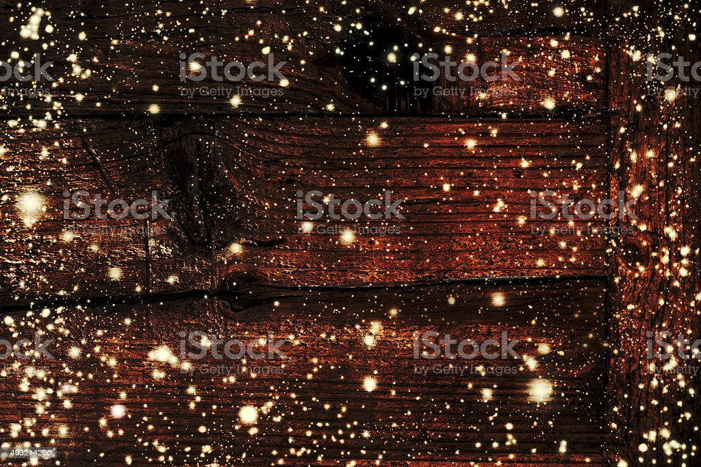 Dark Christmas decoration with falling snowflakes and Xmas light stock photo