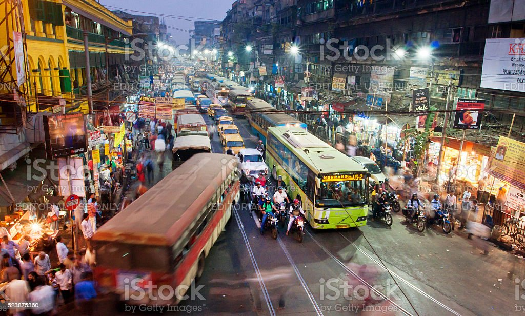 Dark city traffic at late evening in Kolkata stock photo