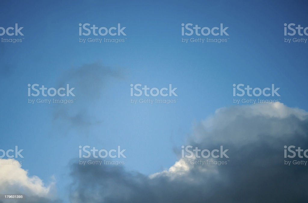 dark cloud in a blue sky space to write royalty-free stock photo