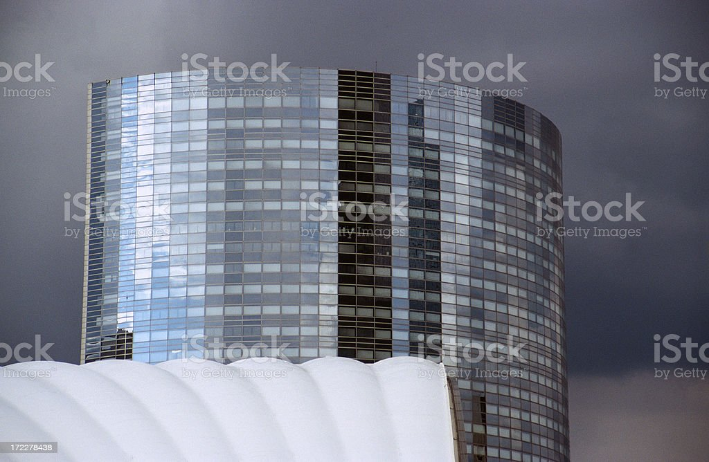 Dark clouds behind office building royalty-free stock photo