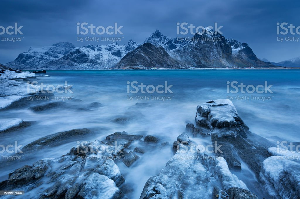Dark clouds over a fjord in Norway in winter stock photo