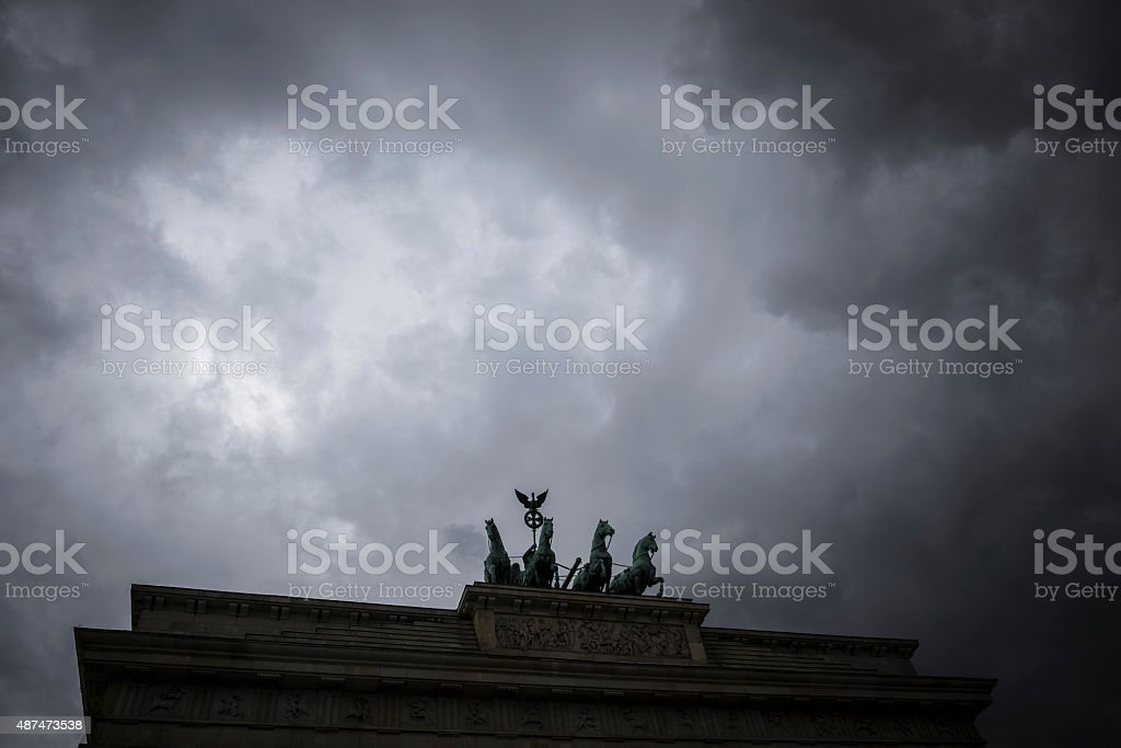 Dark clouds over Brandenburg Gate in Berlin, Germany stock photo