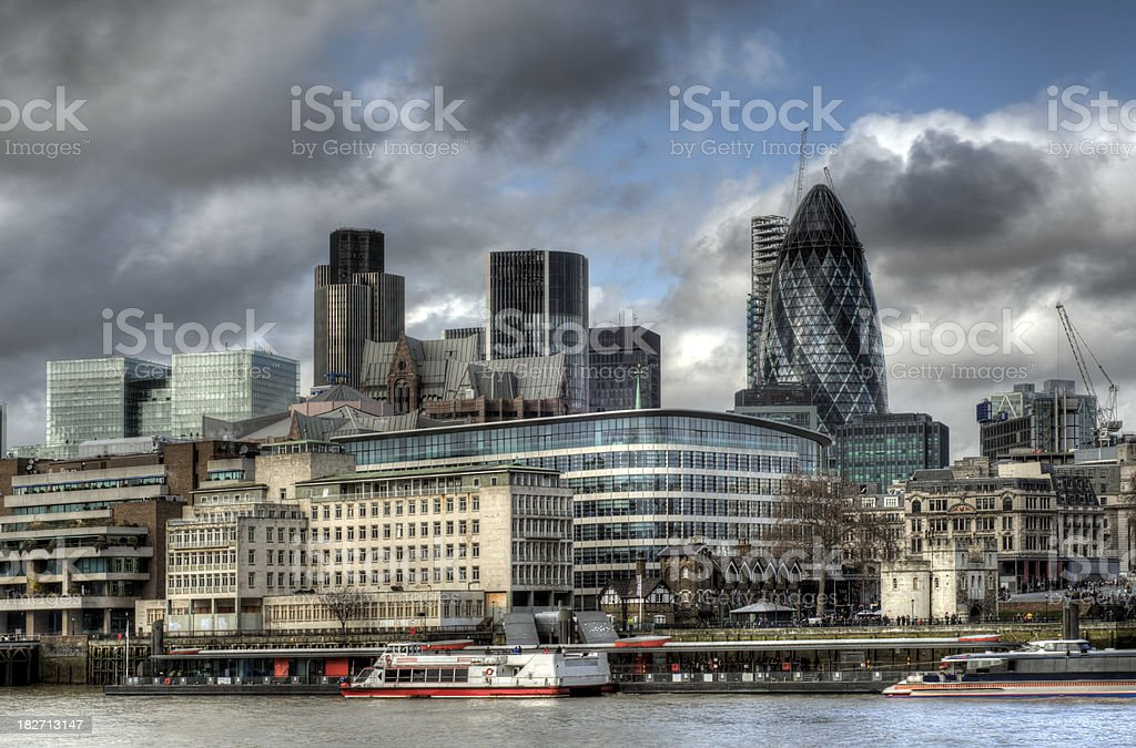 Dark clouds over London financial district royalty-free stock photo