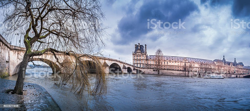 Dark clouds over Royal Bridge and Seine River stock photo