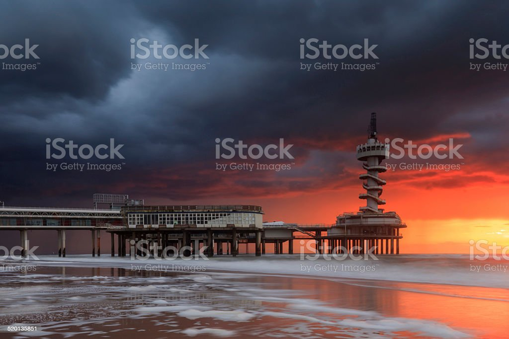 dark clouds over the Pier at Scheveningen stock photo
