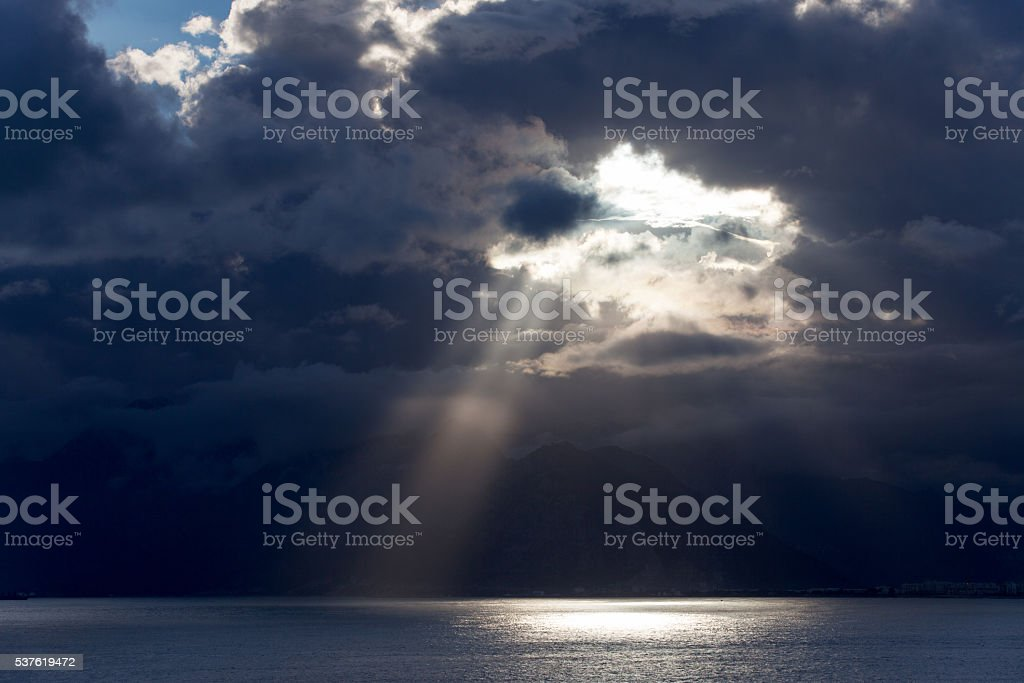 Dark clouds over the sea stock photo