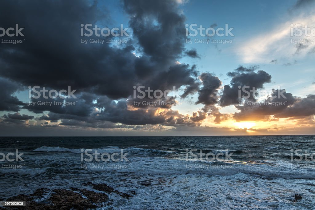 dark clouds over the sea stock photo