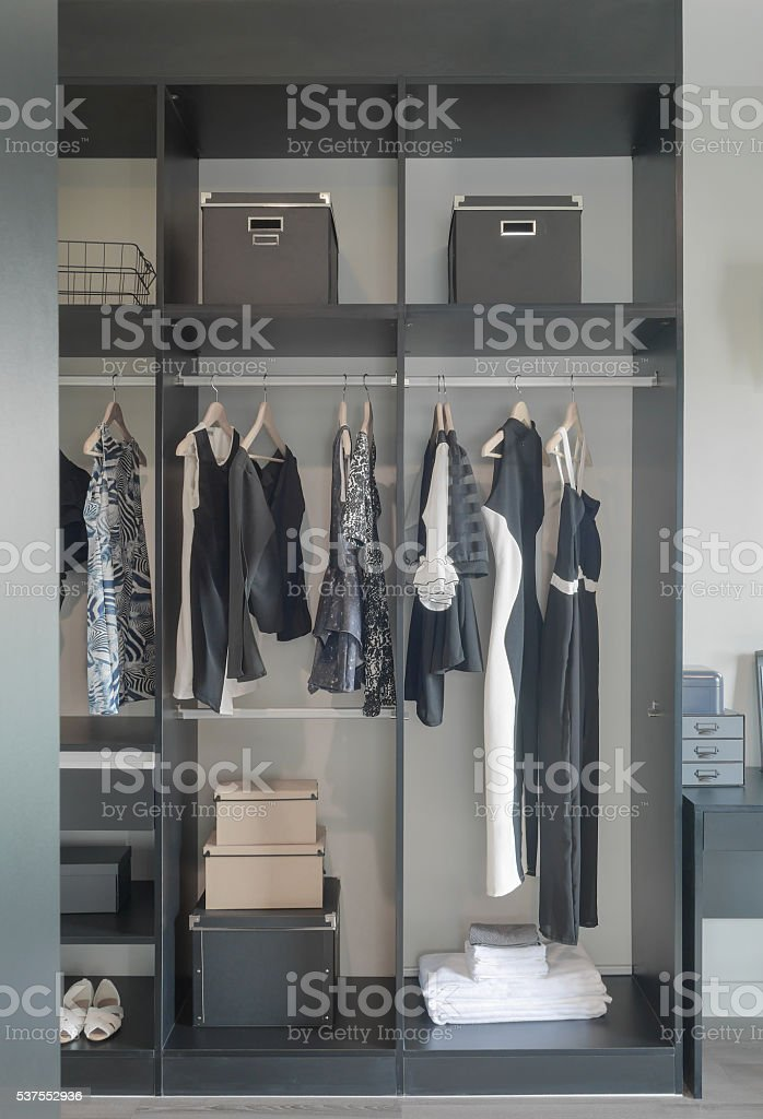 Dark color set up wardrobe for lady stock photo