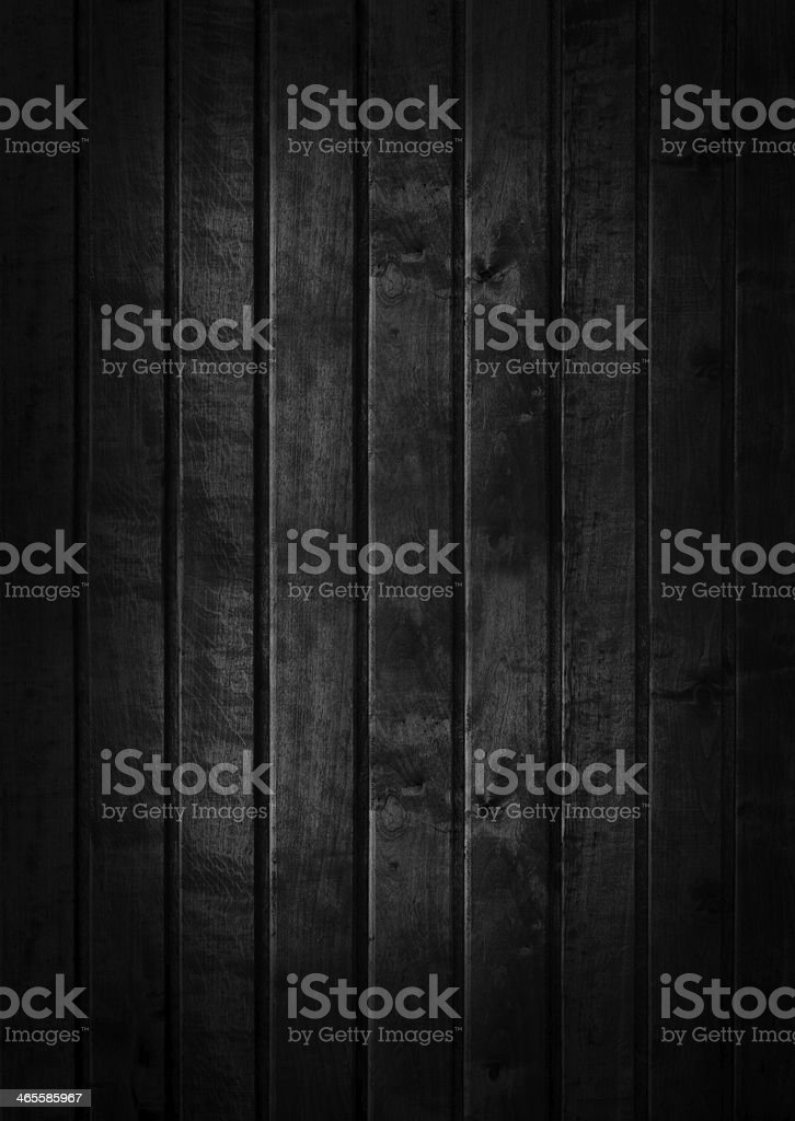 A dark colored wood wall texture stock photo