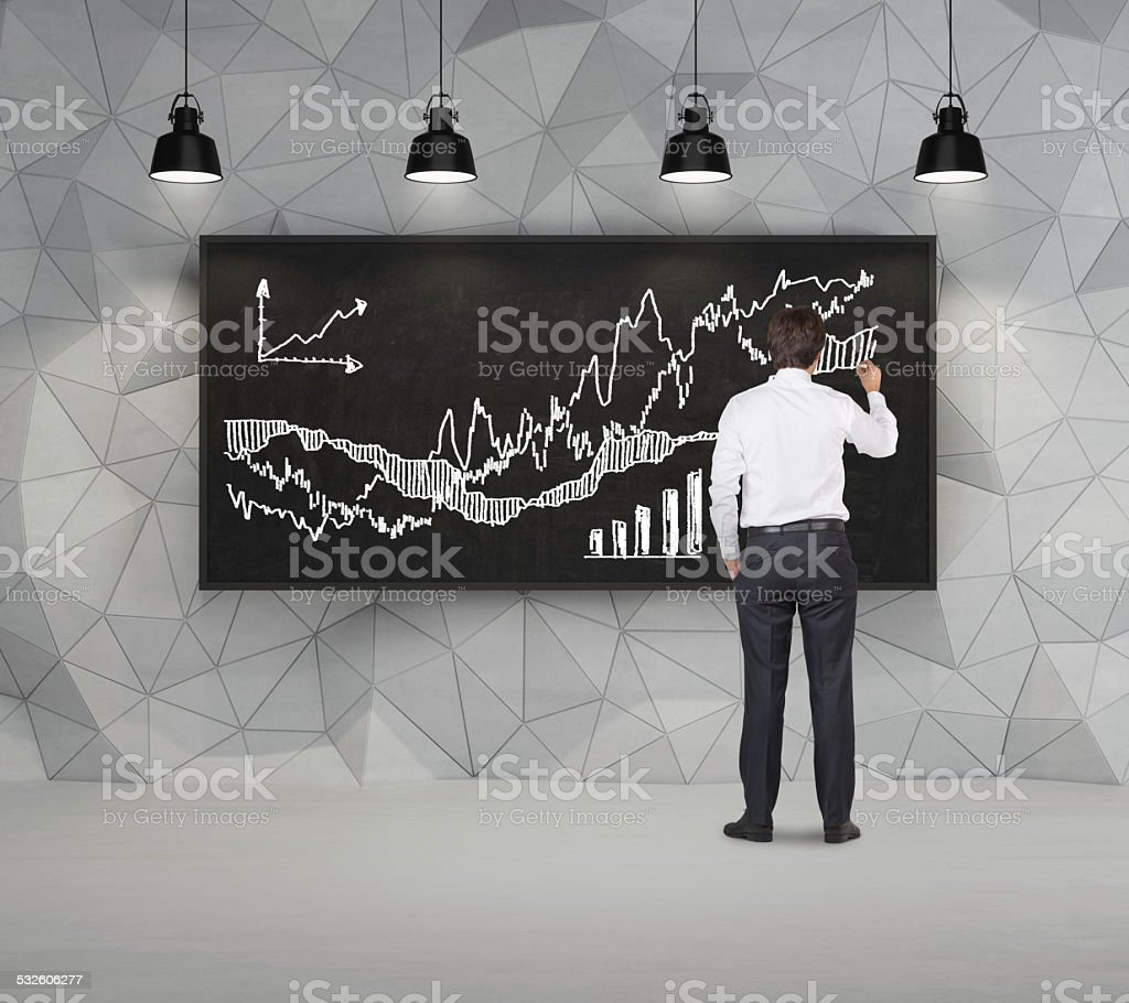 Dark concrete room with board and lamps stock photo